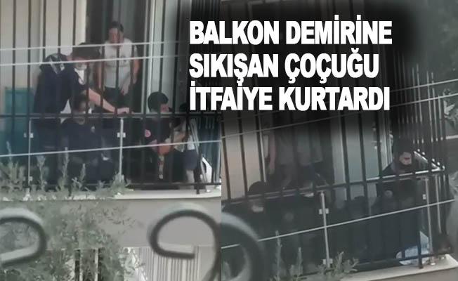 Antalya'da kafası balkon demirine sıkışan çocuğu itfaiye kurtardı