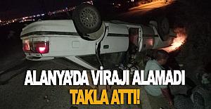 Alanya'da virajı alamayan otomobil takla attı