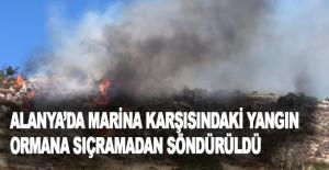 Alanya'da marina karşısındaki yangın ormana sıçramadan söndürüldü